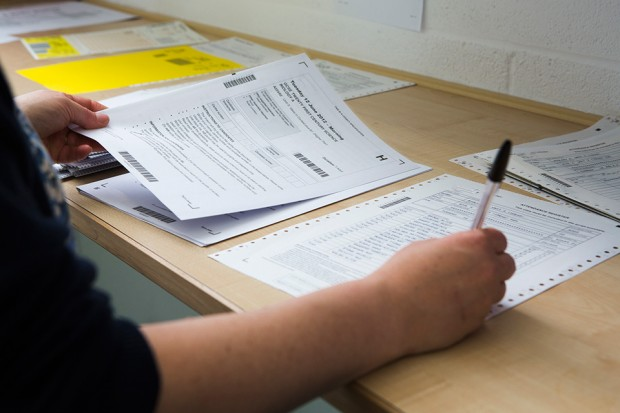 Image of person marking GCSE examination papers