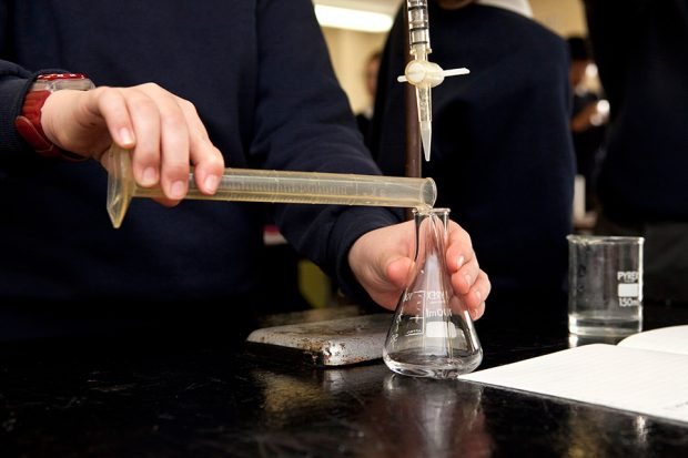 Student performing a chemistry experiment