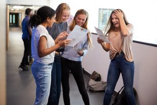 Four teenage girls collecting exam results
