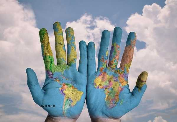 hands painted with map of world